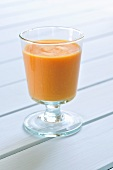 A glass of cream of carrot soup
