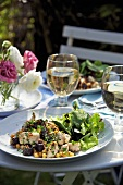 Black pudding with chickpeas and salad