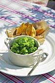 Mushy peas with potato wedges