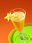Orange and melon juice with a star fruit slice