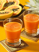 Two glasses of papaya and apple juice