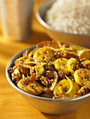 Plantain curry with raisins and pecan nuts