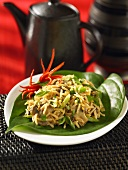 Fried rice with mushrooms on a green leaf