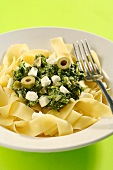 Tagliatelle with spinach, sheep's cheese and olives