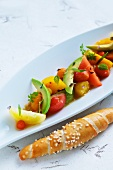 Tomato salad with avocado and salty bread