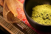 Japanese Matcha Green Tea Powder in a Ceremonial Black Matcha Bowl with Whisk