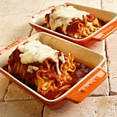 Rolled Cheese Lasagna with Marinara Sauce and Melted Mozzarella in Casserole Dishes