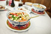 Bowls of Chinese Soup with Shrimp, Chicken and Veggies