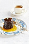 Chocolate pudding with orange sauce