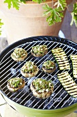 Stuffed mushrooms and courgette slices on a barbecue