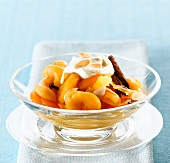 Apricot compote with spices and whipped cream