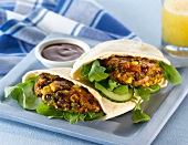 Bean and sweetcorn cakes in pitta bread
