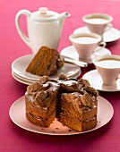 Chocolate cake and cups of tea