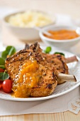 Marinated pork chops with apricot sauce