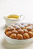 Baked, sweet yeast dumplings with vanilla sauce (Austria)