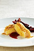 Semolina strudel with crumbled butter and marinated plums