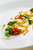 Cream cheese ravioli with pine butter and vegetables
