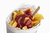 Chips and ketchup wrapped in newspaper