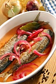 Fried herring in vinegar marinade with red onions
