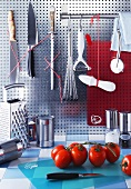 Tomatoes and various kitchen utensils