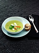 Cream of pea soup with smoked fish
