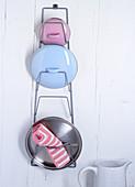Pot lids on a wall bracket