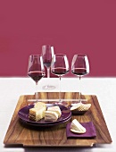 Various soft cheeses, crackers and red wine