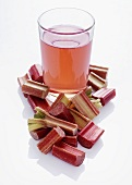 Rhubarb spritzer and pieces of rhubarb