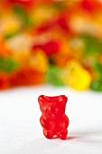 Red Gummie Bear; Many Gummie Bears in Background