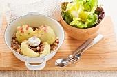 Potato dumplings in bacon sauce with a green salad (Lithuania)