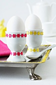 Egg cups decorated with self-adhesive ribbons