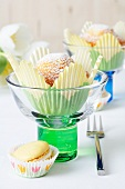 Muffins in tulip-shaped paper cases in ice cream sundae glasses