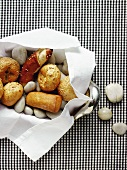 Bread rolls and hot stones in a bread basket