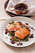 Fried salmon fillet on a bed of lentils