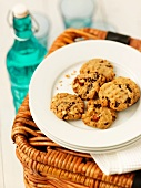 A plate of chocolate and nut cookies on top of a picnic basket