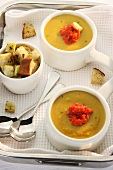 Butternut squash soup with puréed peppers and croutons