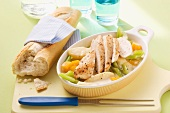 Chicken breast on a bed of creamy vegetables
