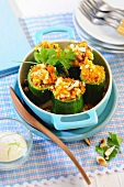 Courgettes stuffed with a spicy couscous and raisin mixture