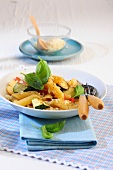 Penne pasta with courgettes and basil