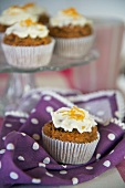 Carrot muffins on a cake stand and on a napkin