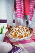 An exotic fruitcake decorated with icing