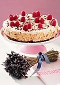 A raspberry cream cake on a cake stand