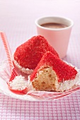 Cakes topped with red hats made of desiccated coconut and sugar sprinkles