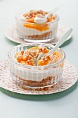 Layered deserts with butter biscuits, mascarpone, cream and quark and apricot sauce