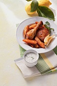 Lemon chicken with potato wedges and a yogurt dip