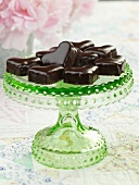 Chocolate Coated Heart Cakes on a Green Glass Pedestal Dish