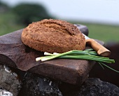 A loaf of bread on a stone slab in the open air (Ireland)