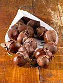Chestnuts with rosemary in a paper bag