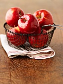Red Prince apples in a wire basket