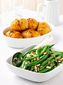 Green beans with almonds and jacket potatoes